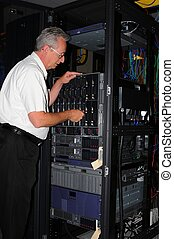 Computer Diagnosis - An engineer examining machine in...