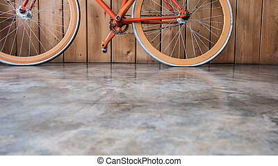 fixed gear bicycle parked with wood wall