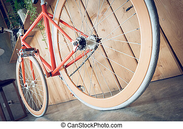 fixed gear bicycle parked with wood