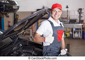 Portrait of an auto mechanic at work
