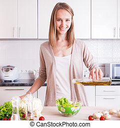 Young Woman Cooking in the kitchen.