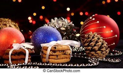 Christmas cookies with decoration on black, bokeh, light, garland, cam oves to the left