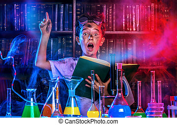 eureka - A boy doing experiments in the laboratory....