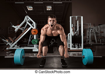 Muscular Men Lifting Deadlift In The Gym