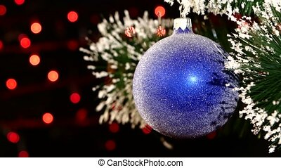 Decoration a toy shiny blue ball hanging on christmas tree, bokeh, light, black, garland