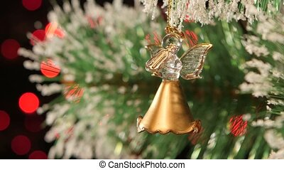 Decoration - a toy angel on christmas tree, bokeh, light,...