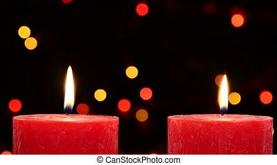 Two red candles with christmas decorations on black, bokeh, light, garland, cam moves top down