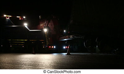 Road repairing a truck at night - Road repairing a truck at...