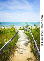 Wooden walkway over dunes at beach - Wooden path over dunes...