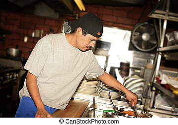 Hispanic cook - Hispanic kitchen staff. Grid spot used on...