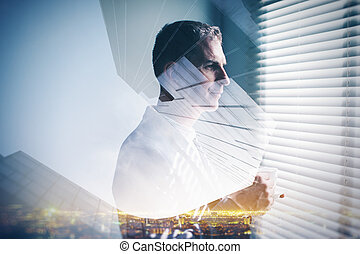 Multiexposure of young business man and night city on the background