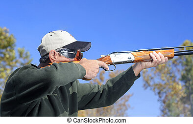 Man Shooting Shotgun - Man shooting a shotgun. Bird hunting...