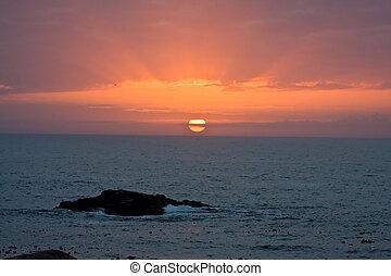 West Coast sunset with lovely orange colours