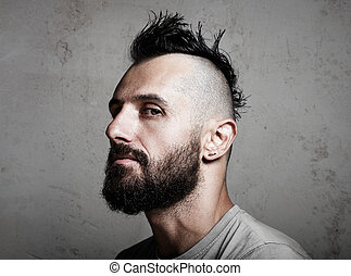 Close-up portrait of a brutal man with mohawk. Horizontal -...