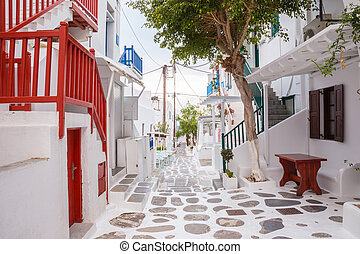 Mykonos town streetview with tree and red banisters, Mykonos...