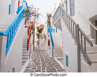 Mykonos town streetview with stairs and blue and grey and...