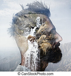 Double exposure portrait of man with mohawk and a mountain -...