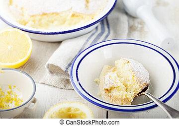 Lemon pudding cake with fresh lemons. Wooden background -...