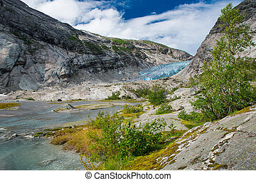 Blue glacier with lake Nigardsbreen in Norway