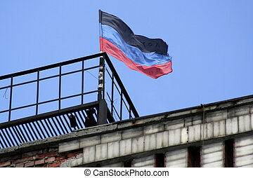 Donetsk Republic flag located on one of the buildings of...