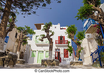 Small square of at Mykonos town with clear blue sky and...