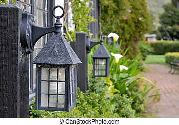 Old fashion lantern lights near path - Focus on first old...