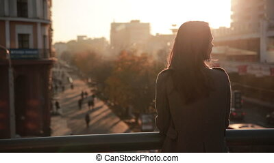 beautiful young girl looks at the city - beautiful young...