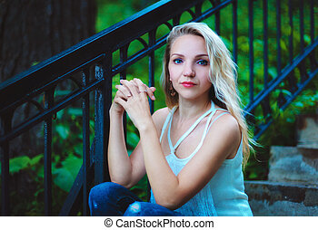 Portrait of a girl - Girl sitting on the stairs