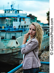 Portrait of a girl on the waterfront on the background of...