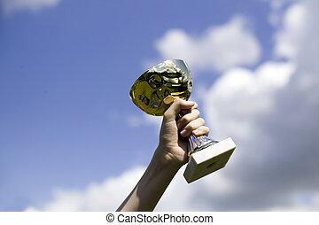 Man holding cup of winning a dance contest, sky background