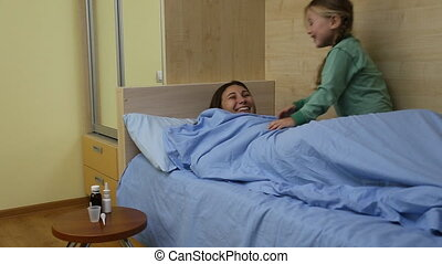 Mom with a child in bed