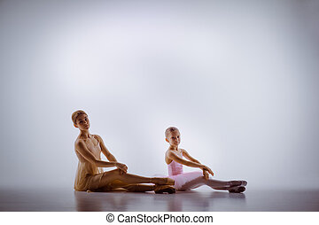 The little ballerina posing with personal teacher in dance...