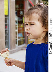 Little girl eating ice cream - Beautiful young little girl...
