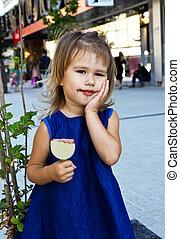 Little girl eating ice cream - Beautiful young little girl...