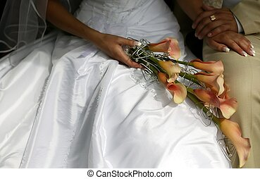 Groom holding bride with flowers