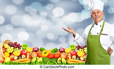 Chef man with fruits and vegetables - Handsome Chef man over...
