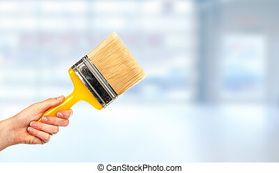 Hand of woman with a brush.