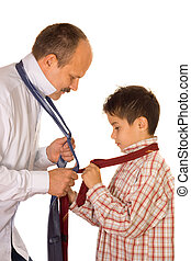 Tie binding - Help concept : father shows his son the tie...