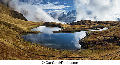 Mountain panorama with lake - Mountain Lake. Panorama...