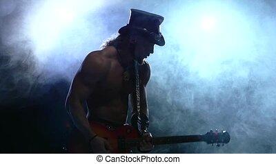emotional strip man playing bass guitar, slow motion, smoke