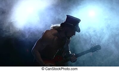 muscles emotional strip man playing bass guitar, smoke, slow...