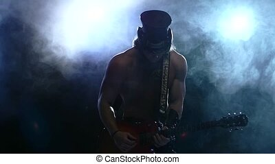 brutal rock strip man playing bass guitar, smoke, slow motion