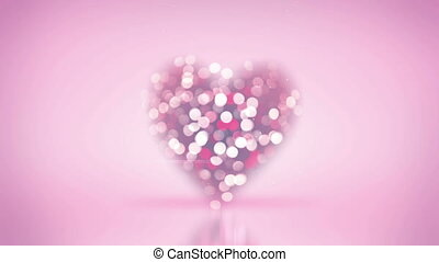 blurred heart shape and bokeh lights seamless loop animation...