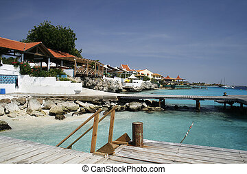 caribbean resort - resort with hotels, docks and bright blue...