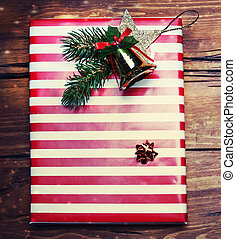 Christmas gifts with on dark wooden background in vintage...