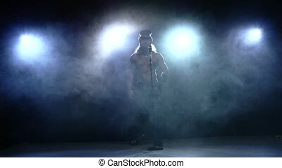 naked strip man in hat singing into a microphone, Slow motion, smoke