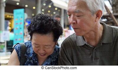 Lovely Asian senior eating ice cream - Asian senior couple...