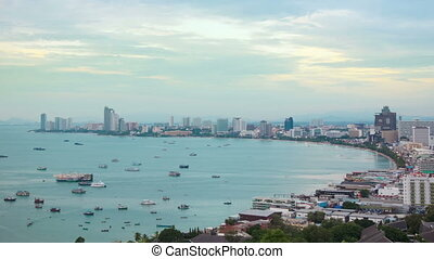 boats in bay of Pattaya city at evening timelapse