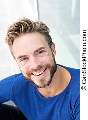 Close up handsome man with beard smiling
