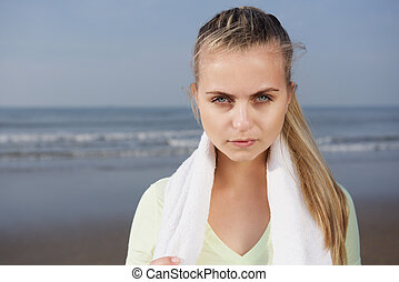 Close up portrait of a sporty female with serious expression...